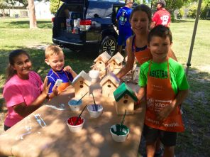 Isabel Fernandez Cardenas, left Devin Egelston, Ada and Roman Van Loon, get crafty at the home depot table.