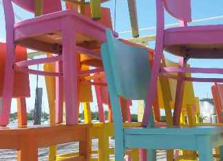 MARATHON: Dockside under new ownership - An umbrella sitting on top of a wooden chair - Florida Keys