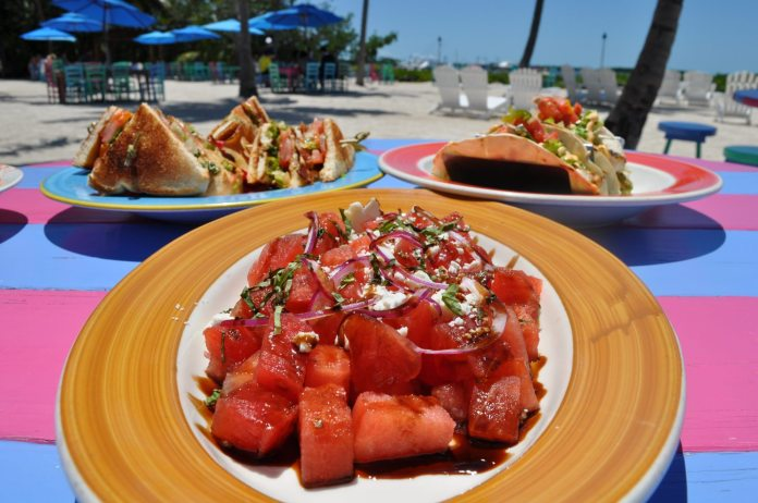 Morada Bay Cafe - A plate of food on a table - Morada Bay