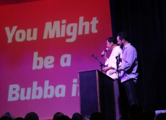 You might be a Bubba… - A man standing on a stage in front of a sign - Public Relations