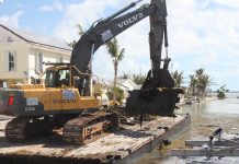 Marine debris removal begins in Keys canals - A large truck - Demolition