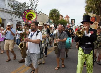 The traditional New Orleans jazz style of the Key West funeral Band and joining musicians, lead the crowd to the Green Parrot.