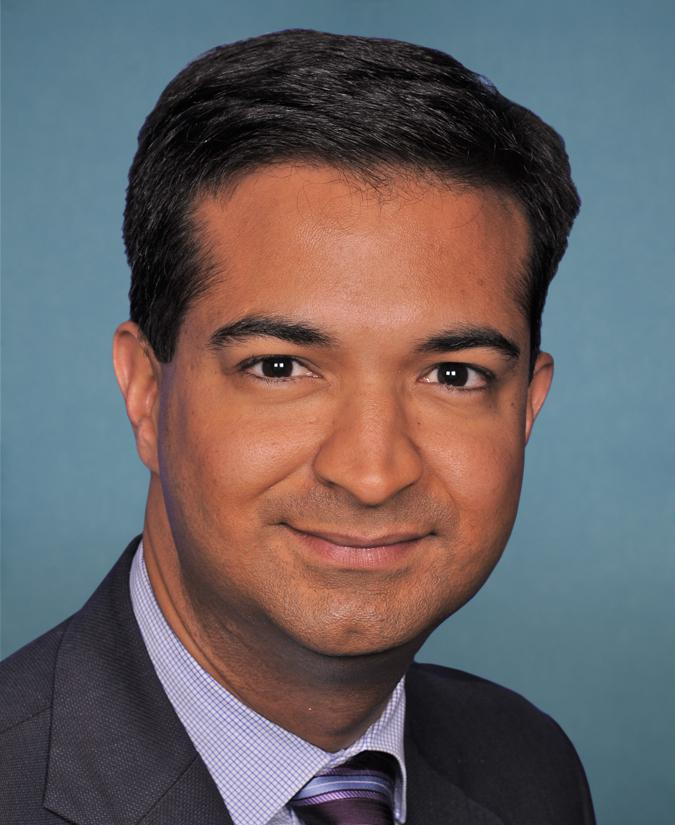 Don't forget to file for hurricane tax relief - Carlos Curbelo wearing a suit and tie smiling and looking at the camera - Carlos Curbelo
