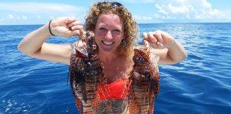 Multi-tasking with Rachel Bowman - A person standing next to a body of water - Red lionfish