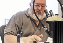 Meet the Bug Doctor - A man cutting a cake - Dean Lyon