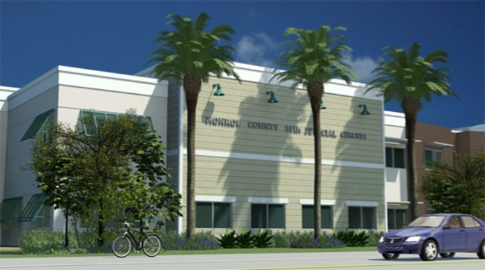 Ready for rebuild – BOCC to staff: Plantation Key courthouse project urgent - A group of palm trees on the side of a building - Plantation Key