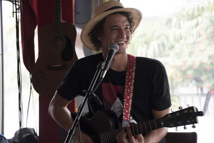'The destination  became Florida' - A man holding a microphone - Bass guitar
