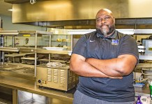 'Chef Flavor' Stanton teaches kids to cook - A man cooking in a kitchen - Chef