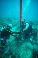 John El-Koury and Scott Black attach a lift bag to a bundle of rope and anchor. The lift bag helps with heavier debris such as big anchors and chain and also allows for a more efficient clean up as it takes the debris to the surface where it will be picked up at the end of the dive.