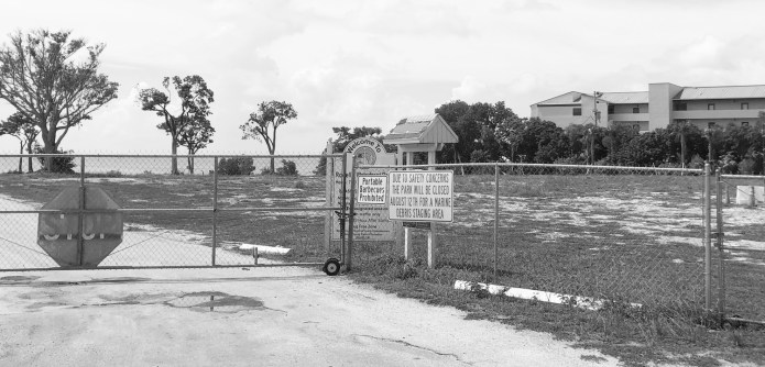 AN AMAZING 'SLIDE SHOW' - A sign on the side of a dirt field - Fence