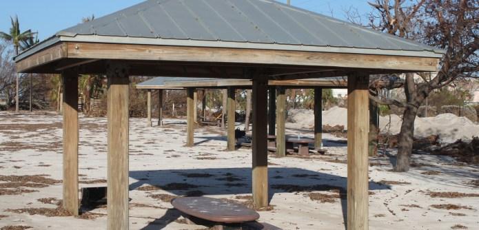 AN AMAZING 'SLIDE SHOW' - A wooden pier next to a beach - Florida Keys