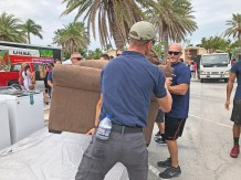 Rubio, Curbelo and more tour Marathon one year after Irma - A man standing next to a palm tree - Marco Rubio