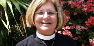Rev. Debra Andrew Maconaughey thoroughly involved in community - A person holding a flower - Floral design