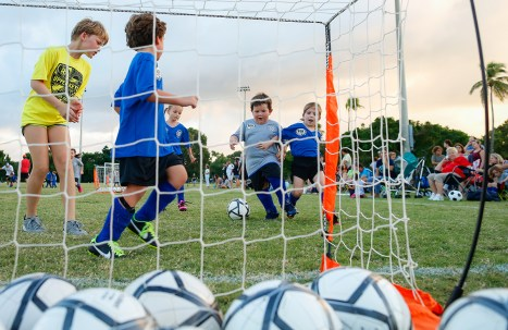 Bryson Ward and Morgan Dockery, both 4 at right center, battle for control of the soccer ball during an Upper Keys American Youth Soccer Organization Region 864 6U team scrimmage at Founders Park in Islamorada Friday evening, September 28, 2018. From left are assistant coach and Upper Keys AYSO 12U team member Violet Matthews, 10, Tristan Vazquez and Ryleigh Daniels, both 5. Photo by Doug Finger Photography
