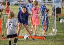Assistant coach Makayla Hann, 12, with the Upper Keys American Youth Soccer Organization Region 864 6U team cheers a goal scored by Patrick Cummings, 4, during practice at Founders Park in Islamorada Friday evening, September 28, 2018. Hann, who plays soccer with the Florida Keys Soccer Club, a traveling team, said she enjoys volunteering her time with the beginner players because she likes seeing them grow their skill level. Photo by Doug Finger Photography
