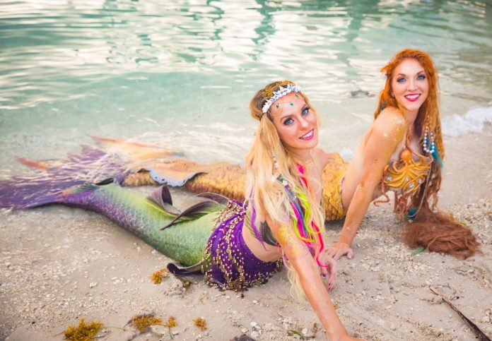 Politics and Mermaids. Yes, We Said it. Now Read It! - A woman lying in a body of water - Fantasy Fest