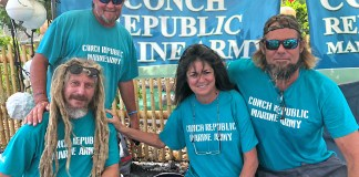 Conch Republic Marine Army keeps growing - A group of people posing for the camera - Conch Republic