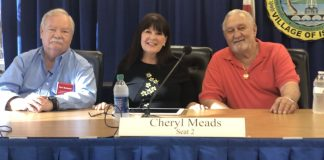 Village Council Candidates Open Up at Forum - A group of people sitting at a table in front of a curtain - Islamorada