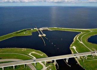 $1.6 Billion Okeechobee Reservoir Takes Huge Step Forward - A small boat in a body of water - Lake Okeechobee
