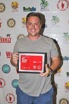Marathon celebrates its best - A man holding a sign - Marathon