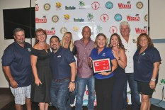 Whoop! Habitat for Humanity of the Middle Keys shows up in force for the win — Best Nonprofit. They are David May, left, Erin Arnett, Ryan Elwell, Meghan Richardson, Matt Bussard, Christine Todd-Young, Christina Gonzalez, Chief John Johnson and Jill Bell.