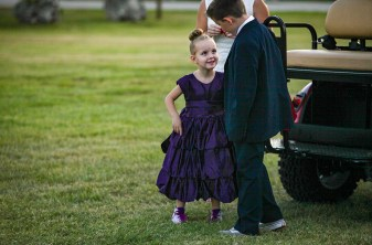 Stella Bennett, 5, looks to her cousin Dean Bennett, 8, of Arizona, during her arrival to the second annual Purple Pumpkin Gala. Photo by Doug Finger