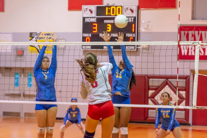 Local Sports: Marathon Volleyball Girls Head to District as 2 Seed - A group of people playing a game of volleyball - Volleyball