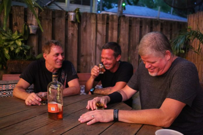 Together Again –Nick Norman Band kicks off First Flight's music season - A group of people sitting at a table - Caffeine Carl Wagoner