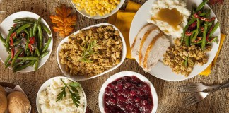 Thanksgiving guide – Where to volunteer, or find a turkey dinner - A bowl filled with different types of food on a table - Thanksgiving dinner