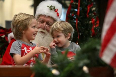 Logan Wojcik, 4, at left, and his younger brother Jax, 2, of Tavernier, meet with Santa.