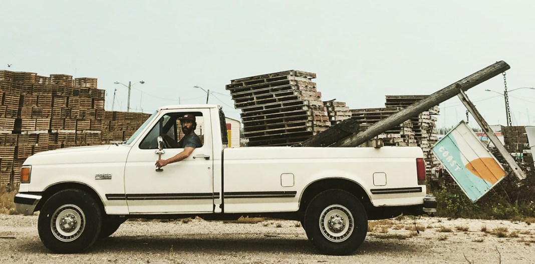 COAST: New Horizons. Original Roots. Rustic Vibes - A truck is parked in front of a car - Ford F-Series