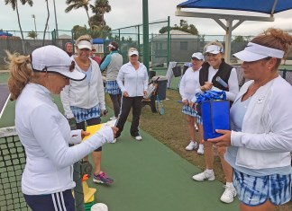 Islamorada tennis team headed to state championship - A group of people standing in front of a crowd - Team