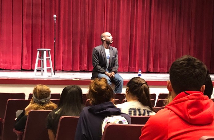 "From Here to ""Heaven"": Rowan Ricardo Phillips visits Key West High School - A group of people standing in front of a curtain - Academic conference"