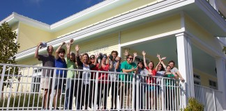 Two Paws Up! New Florida Keys SPCA Facility Opens - A group of people standing in front of a building - Florida Keys