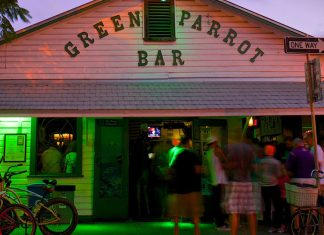 The Ultimate Bucket List: Sloan's picks for best of Key West - A bicycle parked in front of a store - Green Parrot Bar