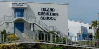 Island Christian School Fights to Survive - A sign on the side of a building - Island Christian School