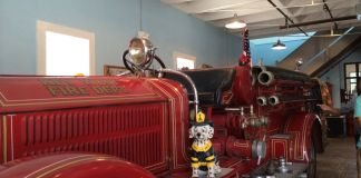 The Bucket List – Local Picks for Best of Key West - A red and black truck sitting on top of a table - Key West Firehouse Museum