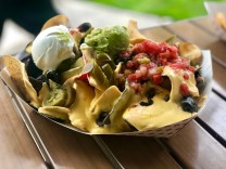 The Pile High Club Nachos live up to their name. SARAH THOMAS/Keys Weekly