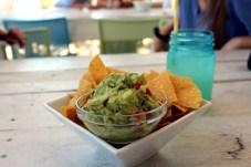 Keys Eats: Bad Boy Burrito - A bowl of food sitting on a table - Guacamole