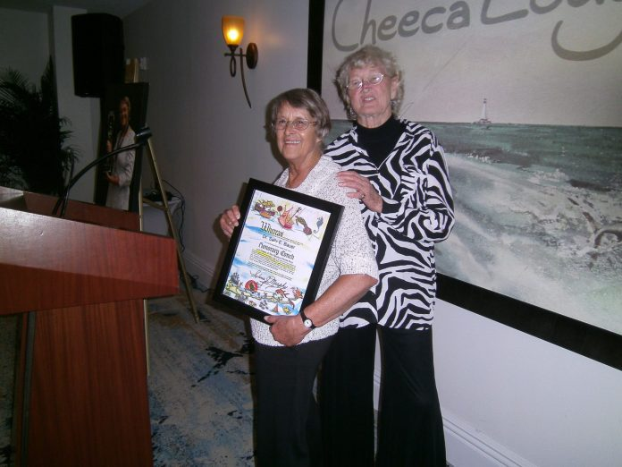 Bauer recognized for work - A person standing posing for the camera - Public Relations