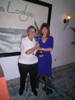 Dr. Sally Bauer with HDM Board Member Patti Gross hold NOGI award.