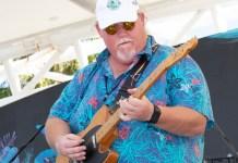 Locals, visitors devour the seafood - A person holding a baseball bat - Florida Keys