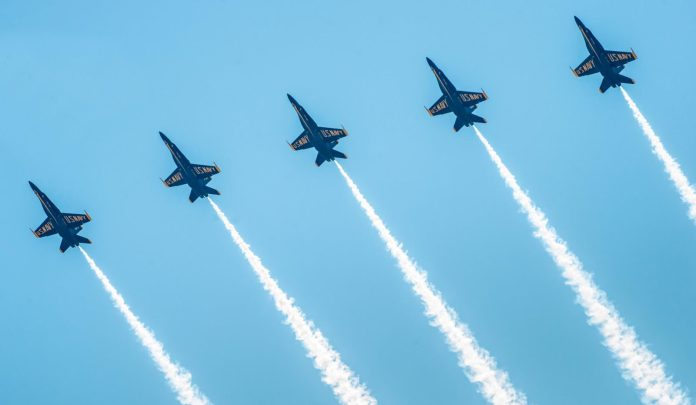 Blue Angels take the skies next weekend, full schedule and info at the link! - A fighter jet flying in the air - Blue Angels