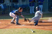Marathon High baseball team begins season - A baseball player swinging a bat at a ball - Catcher
