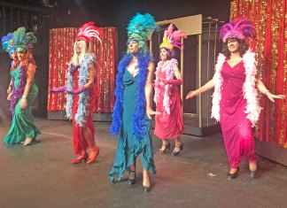 'La Cage Aux Folles' explores human ties with humor and song - A group of people wearing costumes - Folk dance