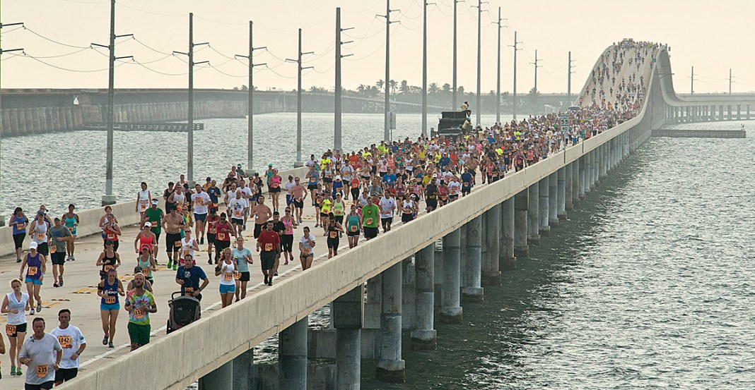2019 runners set sights on 7 Mile Bridge Run - A group of people on a bridge over a body of water - Seven Mile Bridge