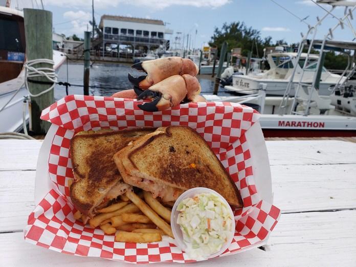 """So Fresh it's Still Flippin'"" at Keys Fisheries - A sandwich sitting on top of a table - Keys Fisheries"