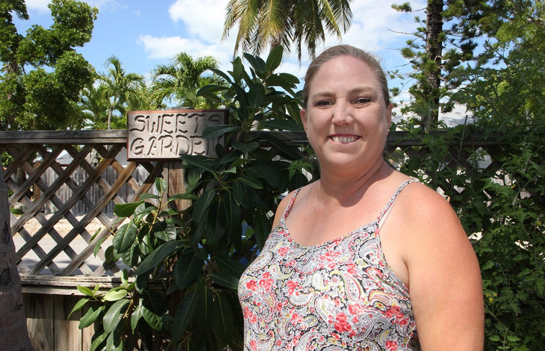Linda Russin made the airwaves personal - A woman holding a sign posing for the camera - Key West