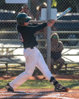 Coral Shores' Dillon Walters hits a single in the first inning against Palmer Trinity on April 22. AUSTIN ARONSSON/Keys Weekly