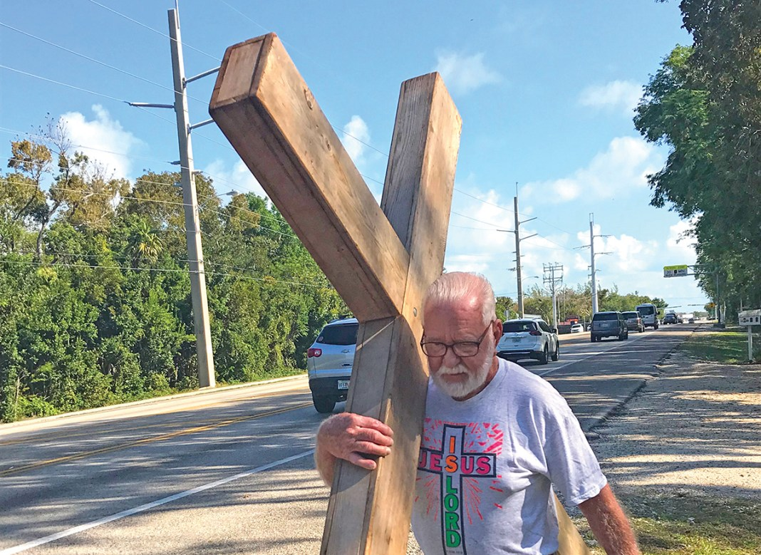 Marlin to carry cross for 33rd time - A man that is standing in the street - Islamorada
